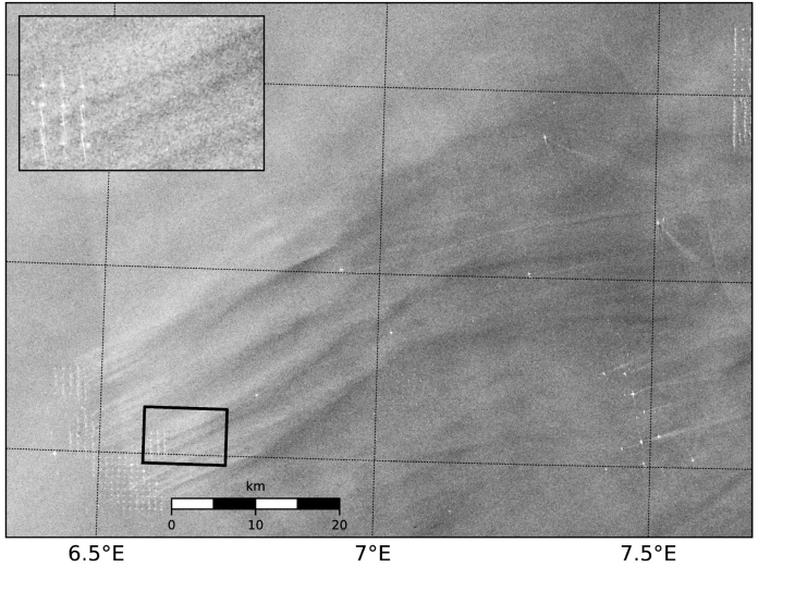 Radar image taken by the Sentinel-1 satellite (ESA) above the Alpha Ventus wind farm from 2015. The bright dots visible in the magnification are the individual wind turbines in the wind farm. Dark areas indicate a smooth sea surface. Areas with higher wind speeds and resulting rougher sea show up as as brighter areas. Source: B. Djath & J. Schulz-Stellenfleth/HZG