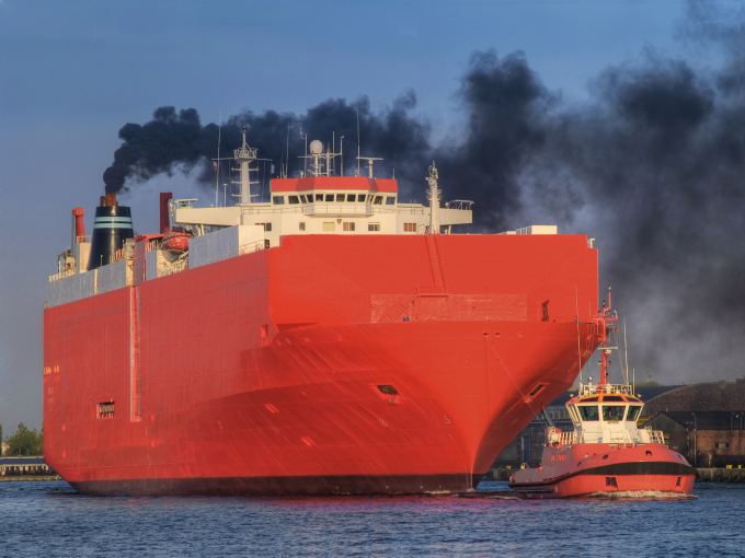 Cargo ship and exhaust gases from the ship's vent